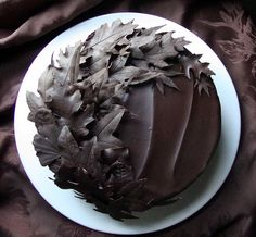 Nice swooping leaf pattern. Could put cake topper if they want to at a jaunty off center position.