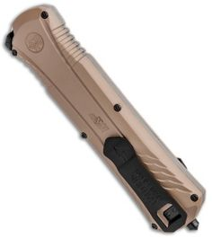 The Smith and Wesson M&P OTF knife is a spring assisted beauty with a black coated blade and tan aluminum handle. Also featuring a safety switch on the handle. Automatic Knives, Smith N Wesson, Glass Breaker, Safety Switch, Safe Storage, Native American Artifacts, Will Smith, Blade, Arrow Necklace