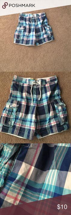 Hollister swim trunks Blue plaid hollister swim trunks. Side pockets. Draw string closure. Lined Hollister Swim Board Shorts