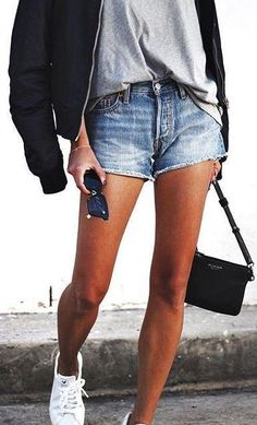 denim shorts. sneakers. plain tee. street style.