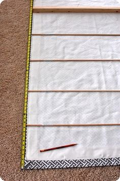 This amazing fully operational roman shade tutorial show you how to make roman shade from any fabric you choose!