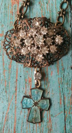 Upcycled vintage brooch and religious medal by RustySpiderweb