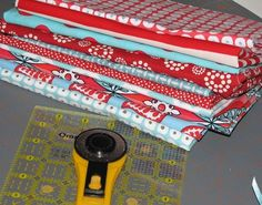 This is what is on my craft table today. I have gathered some of my favorite red and Aqua fabrics, to join in the fun over at Jane's blog ...