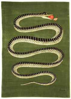 'Snake with apple in its mouth' - a rug! 2008 feat. in Elle Decor magazine. It's produced by Roubini Rugs and is a Piero Fornasetti design.