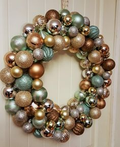 How To Make A Christmas Ornament Wreath. I LOVE Metallic's and Sparkles, This may be my favorite project yet. I was looking to buy new wreath for the holiday season this year. After seeing how expensive they were retail, I decided to try and make my own. I'm so glad I did because it was...