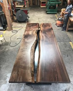 Black walnut conference room table. Gap down the middle so the clients can plug in their laptops into a hidden power strip .... much nicer than seeing a power box cut into the middle