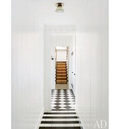 Inspired Hallway Designs That are Far From Boring Amelia T. Handegan designed the painted floors of the hallway in her Folly Beach, South Carolina, home. The stripes chan. House, Interior, Bungalow, White Floors, House Styles, Beach Bungalows, Flooring, Hallway Designs, Architectural Digest