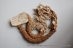 cord from a parachute mine - This is the cord from a German parachute mine dropped on St Loyes Estate, Exeter, on 28th November 1940. - Royal Albert Memorial Museum & Art Gallery, Exeter