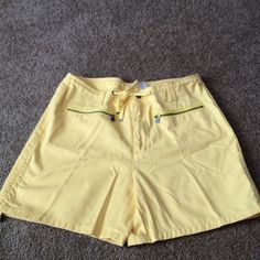 Liz Claiborne Shorts Size 12 Yellow ,zipper snap closure ,four pockets ,2 zippered ,2 snapped. Belt loops and cord waist tie leg tie .NWOT . Cotton Liz Claiborne Shorts Jean Shorts