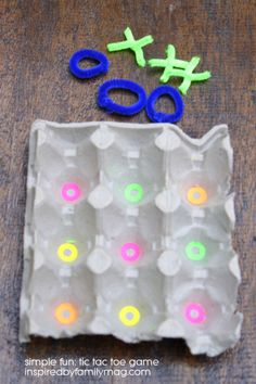 DIY Tic Tac Toe game - The recycled egg carton provides the perfect little holder for your x's and o's