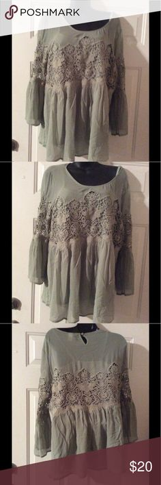 Green blouse with built in camisole. New blouse never worn. Green with bell sleeves. Crocheting in the middle and on sleeves. Excellent condition. torrid Tops Blouses