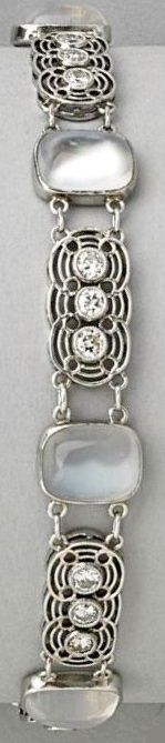 Moonstone and platinum bracelet, by Louis Comfort Tiffany for Tiffany & Co., circa 1915. Cushion-shaped moonstone cabochon links alternate with filigree diamond triplet links, mounted in platinum. Signed Tiffany & Co. #LouisComfort #Tiffany #ArtsCrafts #bracelet