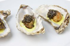 Menu: Fried Oysters with Curried Crème Fraîche; Roasted Poussins and Potatoes; Steamed Artichokes with Cheat's Aioli; Molten Chocolate Cakes