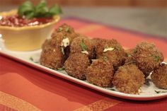 "Un-Fried Rice Balls ""Arancini"": Craving comfort food? Try chef Rocco DiSpirto's healthy spin on fried mozzarella sticks! Join Rocco DiSpirito in the kitchen to..."