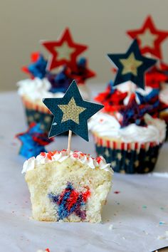 """Firecracker """"Surprise Inside"""" Cupcakes , get your patriotic baking on with stars inside and pop rocks on the top! Firecracker cupcakes tutorial"""