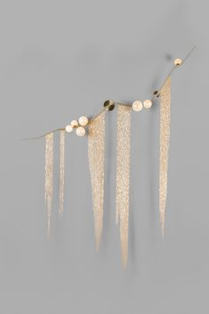 CBF.07.04 in brushed brass, white glass with gold foil, and extra long fringe