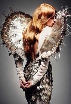 Unfurled mosaic wings of ebony gold & ivory.....