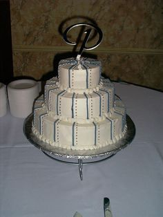 Michelle Mattox Cake:  Winter wedding - Blue and white wedding cake with stripes make with french vanilla batter and buttercream icing for her best friend's daughter.