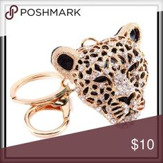 CRYSTAL JAGUAR KEYCHAIN Gorgeous crystal encrusted JAGUAR will dress up any set of keys or handbag or backpack.  Use this as a gift topper in lieu of a bow!                                                                                            PRICE FIRM UNLESS BUNDLED                                                                                     10% OFF 2 ITEMS   15% OFF 3 ITEMS  20% OFF 4 ITEMS  Accessories Key & Card Holders