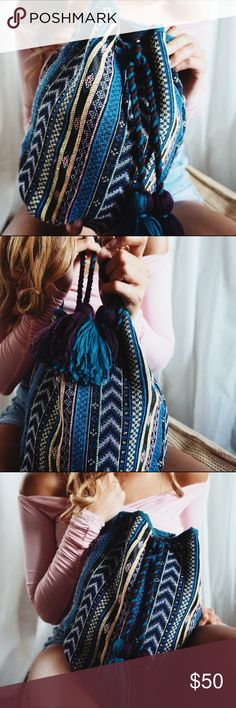 •Phuket Handmade Bucket Bag in Tribal Turquoise• Beautiful  handmade fabric bucket bags from Thailand adding a bohemian free spirited touch. Our handmade Phuket bucket bags are uniquely made therefore there is only one of each fabric available. Each fabric holds an eclectic pattern with multiple vibrant colors also featuring beautiful tassels for added decor.  Carefully choose the fabric as shown in the photos.  •Colors: Bleu Beauty sold inTribal Turquoise pattern in separate listing…