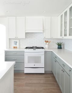 white upper cabinets range wall - blue gray lower cabinets, custom wooden range hood, cabinets by cliq studios