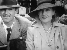 chaplinandkeaton:  Clark Gable, and Carole Lombardwatching a tennis game.