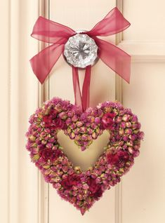 "This carefully handcrafted heart measures approx 7"" from top to bottom.  The buton rosebuds are mixed with burgundy celocia coxcomb, and edged with pink globe amaranth and back with a potpourri of larkspur and globe.  Great for year round or for a gift for someone you love. http://www.katecourysfarmhouse.com/"