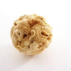Mammoth Ivory Netsuke - The 12 Zodiac animals on a Ball
