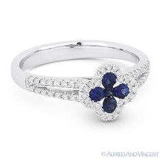 The featured ring is cast in 14k white gold and showcases a flower design set with round cut sapphire petals & center gem accentuated by round cut diamonds all the way around the flower design and along the splitshank band.