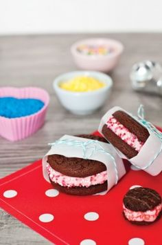 Pink Ice Cream Sandwiches...What a fun and simple idea! Sandwich a scoop of softened ice cream between two chocolate or chocolate chip cookies and then roll the sandwich in pink sprinkles or crushed up candy cane. Wrap up with parchment or waxed paper and tie with string or baker's twine.     Going to make for my valentines!