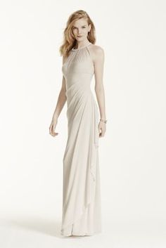 Ultra-feminine and unique this bridesmaid dress has unparalleled details that create a figure flattering silhouette!  Sleeveless illusion neckline with back keyhole is eye catching and chic.  Long softmeshbodicehas cascading side ruffles and back ruching for a flawless finish.  Fully lined. Back zip. Imported polyester. Dry clean only.  Also available in Extra Length as Style 4XLF15662.  Sizes and colors are available in limited stores and with limited availability. To