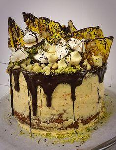 Orange and macadamia birthday layer cake, with chocolate and pistachio dipped meringue kisses, praline shards and chocolate ganache...gluten free  https://www.facebook.com/thesilvaspoon http://www.thesilvaspoon.com.au