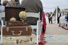 Beach ceremony decorated with travel themed items. Photo by Heather Elise Photography, Planning by Stephanie Rose Events