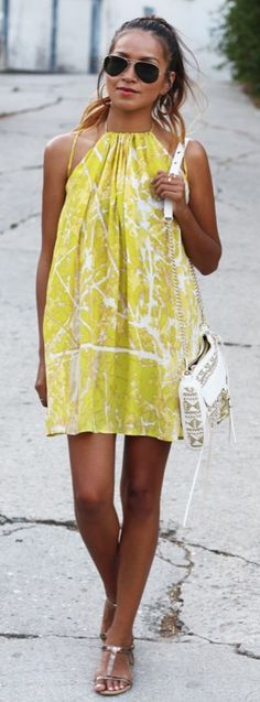 A yellow halter dress will not only show off your new tan, but also feature your toned shoulders.