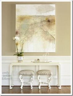 Console Table - Pretty matching benches with large hanging picture.