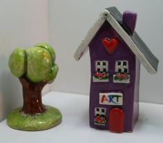 Clay Art Cottage in Purple with a Red front door by HeartHomes