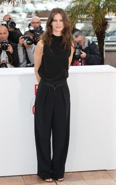Jumpsuits are the best because they're one-and-done easy. Black jumpsuits are even better than the rest, though, because they feel less trendy and more sophisticated, especially in flowy cuts like this one.