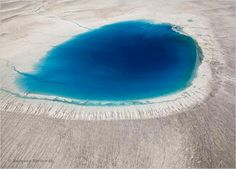 Aerial view of meltwater lake on Greenland's ice sheet.