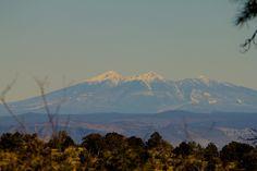 The San Francisco Peaks seen outside Jerome Arizona with a telephoto lens.
