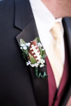 Who could forget the mini football boutonniere?-----Photo Courtesy of Look Wedding Photography