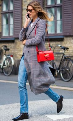Red Loewe bag. Photographed by Style Du Monde.