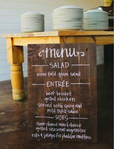 Find an old piece of wood and paint the menu right on top.