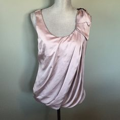 Beautiful H&M top Beautiful dressy silky feel top. Has bow on left shoulder. No flaws H&M Tops