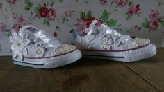 These miniature wedding converse are perfect party shoes for bridesmaids and flower girls. They are hand decorated with lace and pearl beads.