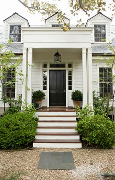 Benjamin Moore Swiss Coffee for a Traditional Exterior with a Black Front Door and Rustic Canyon New Home by Tim Barber Ltd Architecture Front Door Paint Colors, Painted Front Doors, Exterior Paint Colors, Exterior Design, White Exterior Paint, Exterior Siding, Black Exterior, Paint Colours, Modern Exterior