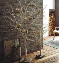 Branchy lighted birch trees, make an elegant addition to decor during the holidays and beyond. Bendable paper- wrapped branches have mini lights embedded in their tips Small and large trees are mounted on reclaimed wood bases.