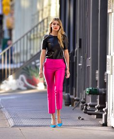 Maybelline commercial in New York City w/Gigi Hadid. The pumps bright color & bold colored pant, way above the ankle, looks adorable.