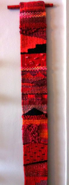 Joan Kendall weaving: A red strip.