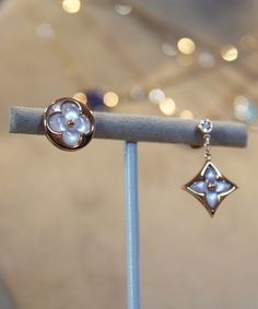 Louis Vuitton Color Blossom BB mother of pearl mis matched earrings in gold with mother of pearl.