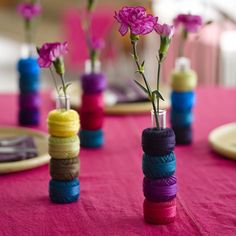 Simple #centerpiece ideas for a #wedding #reception: colorful #yarn rolls, a #vase, and beautiful #flowers.